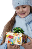 Portrait of the girl with a Christmas gift. Portrait of the girl with a Christmas gift on a white background Royalty Free Stock Images