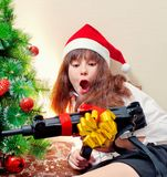 Portrait  girl with Christmas present Stock Photos