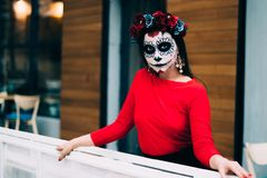 Portrait of a girl in the city with a make-up, make-up for halloween, day of the dead, zombies. dead among us, ghost. walk of skel royalty free stock image