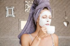 Portrait of a girl with a clay mask on the face Royalty Free Stock Photo