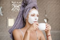 Portrait of a girl with a clay mask on the face Stock Photos