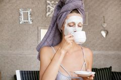 Portrait of a girl with a clay mask on the face Royalty Free Stock Photography