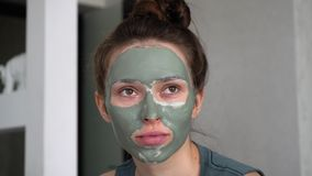 Portrait of a girl in a clay mask. For the face stock footage