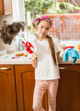 Portrait of girl cleaning mess on kitchen with cloth and brush Royalty Free Stock Image