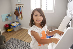 Portrait Of Girl Climbing Ladder To Bunk Bed Stock Photos