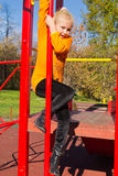 Portrait of a girl. Girl climbs the ladder on the playground Royalty Free Stock Image