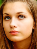Portrait of girl close up. Young beautiful girl in which eyes belltower is reflected Royalty Free Stock Photography