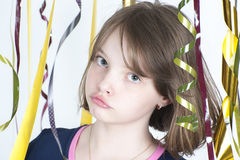 Portrait of the girl close up among the multicolored confetti. Stock Photography