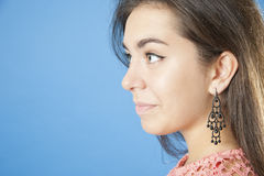 Portrait of the girl close up in profile. Royalty Free Stock Images