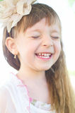 Portrait of a girl. Closeup summer portrait of a cute little girl outdoors Stock Images