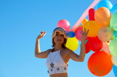Portrait of a girl with colorful balloons. Portrait of a girl with different colored balloons and the blue sky Stock Photography