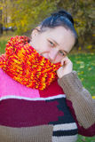 Portrait of a girl. In a colorful knit scarf stock photo
