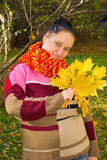 Portrait of a girl. In a colorful knitted scarf with a bouquet of yellow leaves Stock Photography