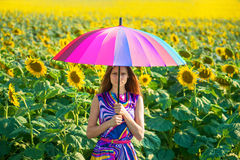 Portrait of a girl with colorful umbrella royalty free stock photo