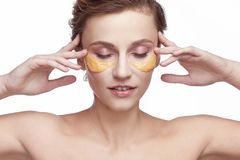 Portrait of a girl with a cosmetic beauty  mask on her face Royalty Free Stock Image
