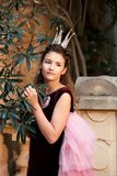 Portrait of a girl in a fairy costume dress of a princess in the garden of an ancient castle stock images