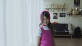 Portrait of girl in costume posing and smiling at camera. Portrait of cute girl in costume posing and smiling at camera. Full HD stock video