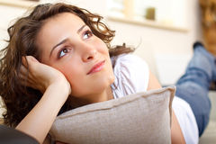 Portrait of a girl on a couch daydreaming Royalty Free Stock Images