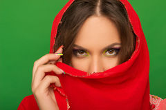 Portrait of a girl covering her mouth with a red handkerchief Royalty Free Stock Photos