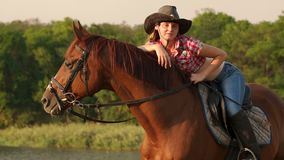 Portrait of a girl in a cowboy hat riding a horse. stock video footage