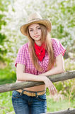 Portrait of the girl - cowboy at an old fence Royalty Free Stock Photo