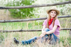 Portrait of the girl - cowboy at an old fence Stock Photo