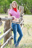 Portrait of the girl - cowboy at an old fence Royalty Free Stock Image