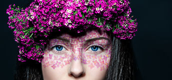 Portrait girl with creative make-up and flowers stock photo