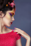 Portrait of a girl with creative make-up. Stock Photos