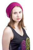 Portrait of girl in crimson hat and T-shirt Royalty Free Stock Photography