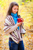 Girl with a coffee outside Royalty Free Stock Photo