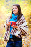 Girl with a cup in autumn forest Royalty Free Stock Photography
