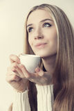 Portrait of a girl with a cup of coffee Royalty Free Stock Images