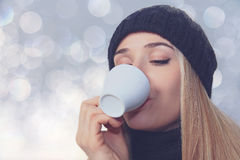 Portrait of a girl with a cup of coffee Stock Image