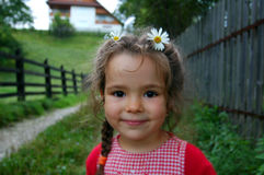 Girl with daisies in hair Royalty Free Stock Photo