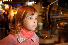 Portrait of girl in dark room of museum space Stock Photos
