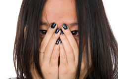 Portrait girl in despair shuts face with hands. Close-up portrait girl in despair shuts face with hands.Isolated on white background Stock Photo