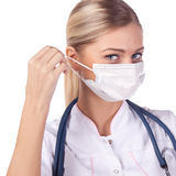 Portrait of a girl doctor in a mask Stock Photos