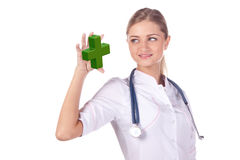 Portrait of a girl doctor. think. Confidence cure Royalty Free Stock Image