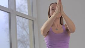 Portrait of girl doing breathing exercise to calm her breathing and relax stock video footage