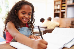 Portrait Of Girl Doing Homework At Table royalty free stock photo