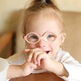 Portrait of a girl with Down syndrome royalty free stock photo