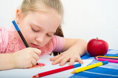 Portrait of girl drawing with pencils. Closeup portrait of girl drawing with colorful pencils Stock Photo