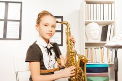Portrait of girl in dress with alto saxophone Stock Image