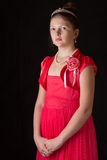 Portrait of a girl in a dress on black background Stock Photos