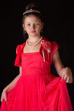 Portrait of a girl in a dress on black background Royalty Free Stock Photography