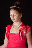 Portrait of a girl in a dress on black background Royalty Free Stock Photo