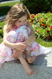 Portrait of girl at the dress with flowers Royalty Free Stock Photography