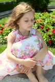 Portrait of girl at the dress with flowers Royalty Free Stock Image