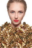 Portrait of a girl dressed in a gold leaf on white background Royalty Free Stock Photos